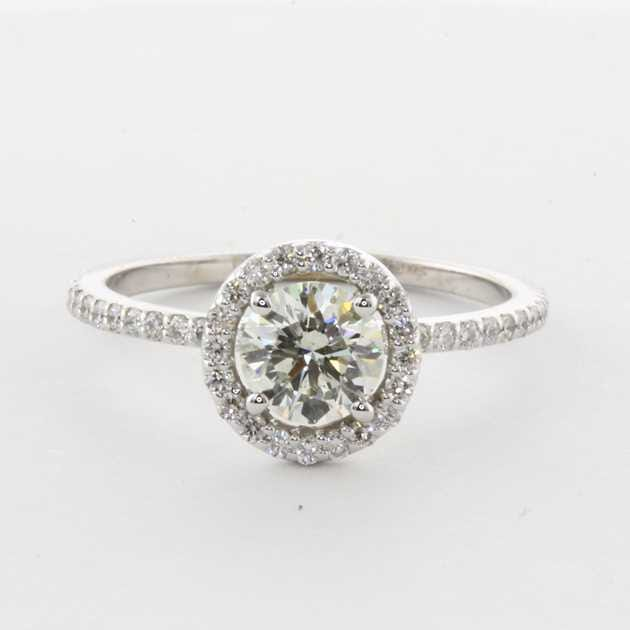 18K White gold halo set with 0.77 carat round.
