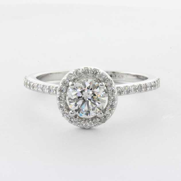 Platinum ring set with 0.70 round diamond.