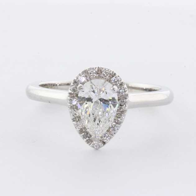 18K White Gold Pear Shape Halo Engagement Ring set with Pear Diamond, 0.70 Carat.