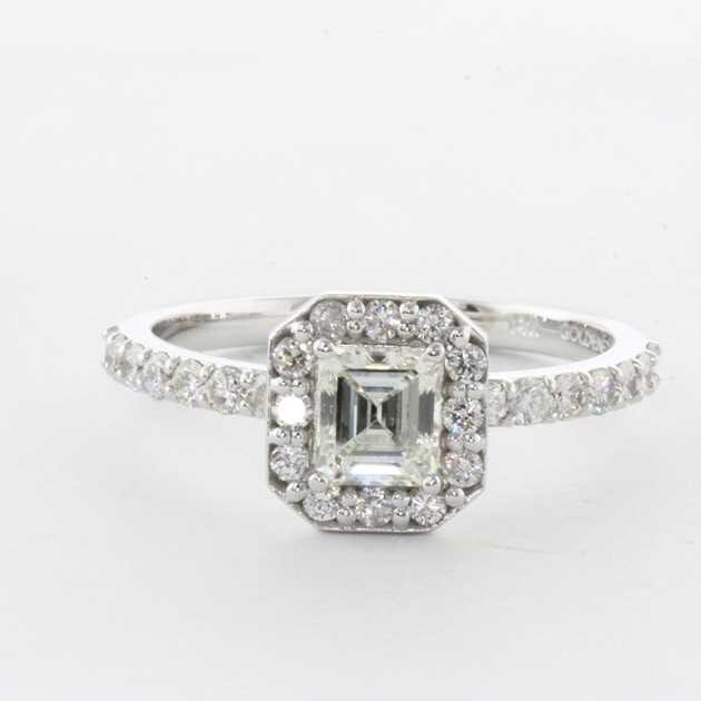 halo emerlad cut diamond ring