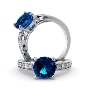 5691 - Round BlueTopaz Diamond Ring With Channel Set Band