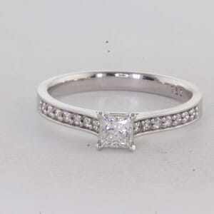 7296 - Channel Set Side Diamonds Engagement Ring